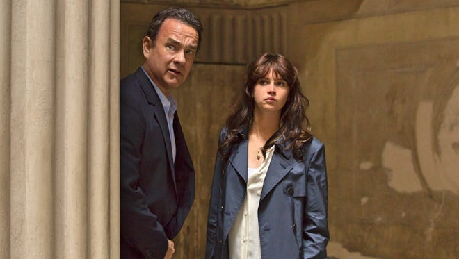"""Langdon (Tom Hanks) and Sienna (Felicity Jones) look for a way out of the Palazzo Vecchio in in """"Inferno."""""""