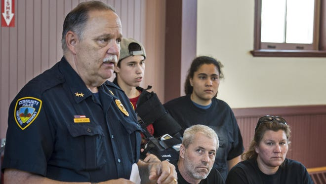 At a Thursday hearing, Hinesburg Police Chief Frank Koss discusses the double fatal crash in April in which a speeding Joseph Marshall lost control of his car, killing himself and cyclist Richard Tom. Looking at Koss is Gary Marshall, Joseph's father. Next to him is Joseph's mother, Alicia. Behind them are his brother Corey and sister Harley.