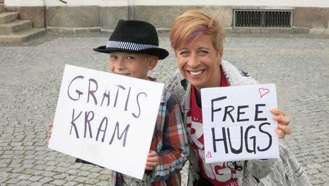 Storyteller Kristin Pedemonti, pictured here in Denmark, has been working with the Free Hugs Campaign all over the world since 2008.
