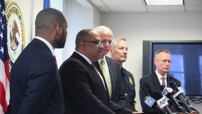 COPS Office Director Ronald Davis (second from left) speaks as former Madison Police Chief Noble Wray (far left), Milwaukee Mayor Tom Barrett (center), Milwaukee Police Chief Edward Flynn and then-acting U.S. Attorney for the Eastern District of Wisconsin Gregory Haanstad (right) listen at the Federal Courthouse in downtown Milwaukee in December 2015.