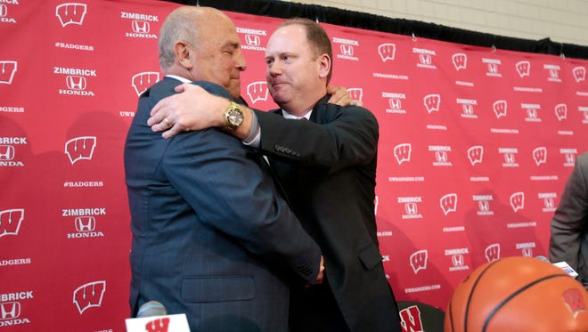 Wisconsin head coach Greg Gard, right, embraces athletic director Barry Alvarez after an introductory NCAA college basketball press conference at the Nicholas Johnson Pavilion in Madison on Tuesday.