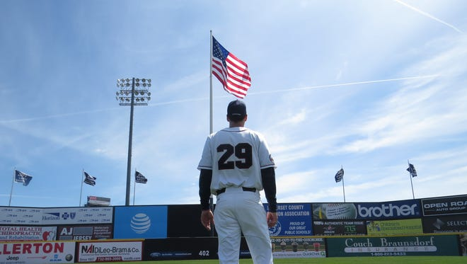 Somerset Patriots manager Brett Jodie looks out at the franchise's five championship banners above TD Bank Ballpark. A sixth will be raised Thursday, marking their 2015 title.