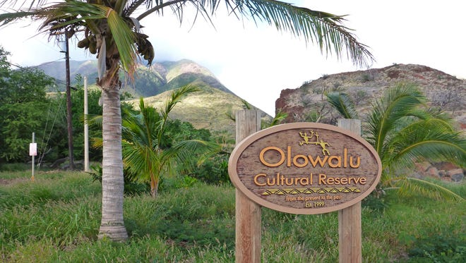 """The Olowalu Cultural Reserve on Maui's west side preserves some 70 ancient rock writings or petroglyphs. According to Maui historian Katherine Smith, the earliest occupation in the Hawaiian islands was around 600-800 A.D. The Olowalu valley was a place of refuge or """"Pu'uhonua,"""" where those who were oppressed could flee. It is a sacred site to Native Hawaiians."""