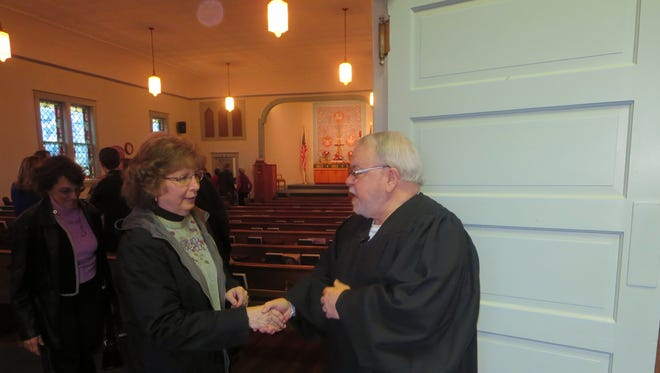 St. Lucas Parishioner Diana Meyer is greeted by David Marshall following Sunday Services