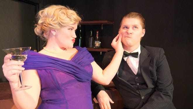 """Reno Sweeney (Chelsea Ealum) sizes up Billy Crocker (Jon Mathes) before making her move in Quincy Music Theatre's """"Anything Goes."""""""