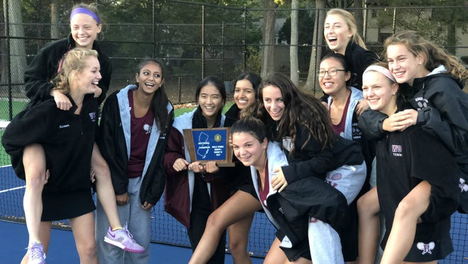 Ridgewood's girls tennis team celebrating after winning North 1, Group 4 title.