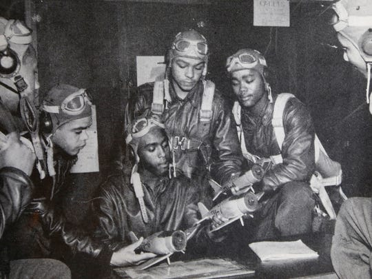 Tuskegee Airman Walter Manning, center, with several other pilots looking over model P51 Mustangs in Alabama before fighting in World War II.  Manning was shot down in Austria during the war and later lynched by a mob. He was honored in a commemoration in Austria on Easter Sunday of this year.