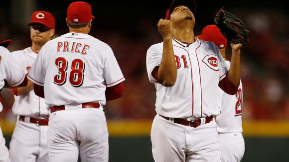 Reds starting pitcher Alfredo Simon looks skyward just after being pulled during the seventh inning of a game against the Chicago Cubs on Wednesday at GABP.