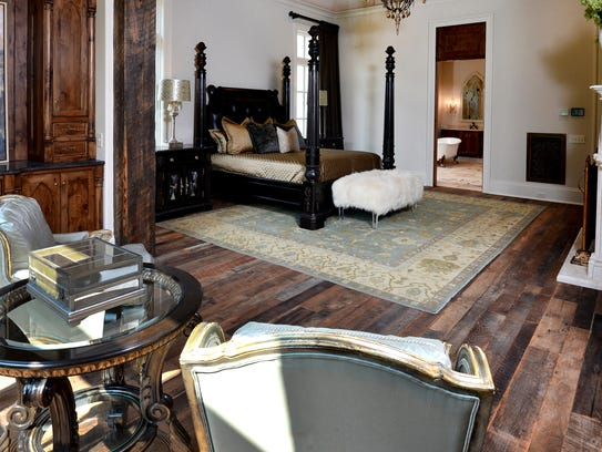 The master bedroom in Schumacher Homes' English Tudor-inspired