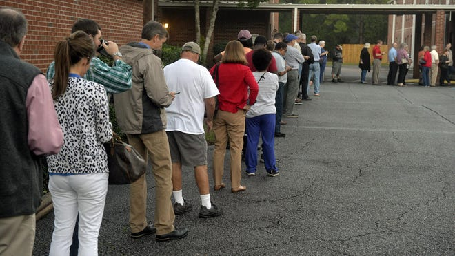 About 60 voters were in line at Windsor Forest Baptist Church when the polls opened at 7 a.m.