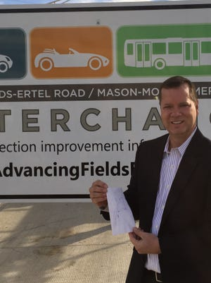 Warren County Commissioner David Young near the newly completed Fields Ertel exit ramp. He thought of the concept 10 years ago and documented his idea on a napkin.