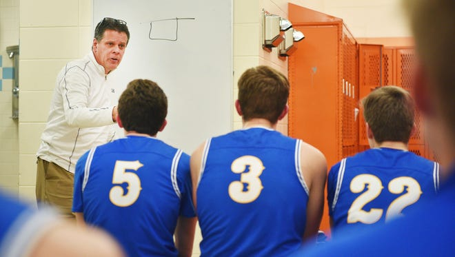 O'Gorman coach Derek Robey talks to the players at half time during the game against Washington Tuesday, Jan. 9, at Washington in Sioux Falls.