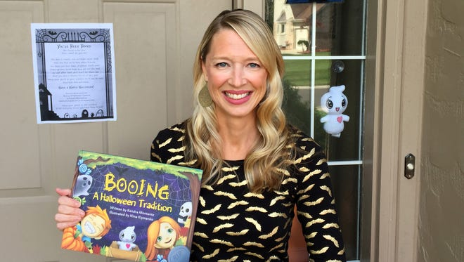 """Kendra Montante of West Bloomfield wrote the book """"Booing: A Halloween Tradition."""""""