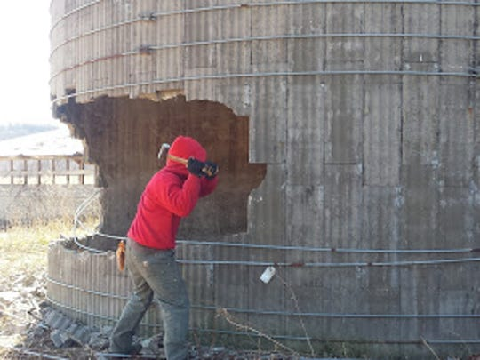 Knocking down a 60-foot silo with a sledge hammer.