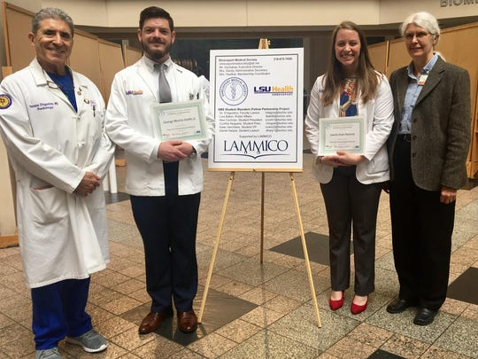 Dr. Horacio D'Agostino (left), professor and chairman of radiology, and Dr. Jane Eggerstedt (right), vice chancellor of academic affairs and School of Medicine Vice Dean, award second-year medical students George Smith and Kate Ramsey, who tied for first place at the Student Research Symposium held by the Shreveport Medical Society-Medical Student Partnership.