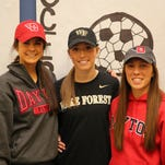 St. Ursula Academy had its Signing Day Feb. 4. From left: Haley Jordahl of Loveland, daughter of Scott and Pamela Jordahl, committed to play Division I soccer at Wake Forest University; Hanna Merritt of Milford, daughter of Tom and Paula Merritt, has committed to play Division I soccer at The University of Dayton; Madeleine Morrissey of Newtown, daughter of Michael and Jennifer Morrissey, has committed to play Division 1 soccer, also at The University of Dayton. Send more Signing Day photos to mlaughman@enquirer.com.