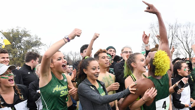 Adams State's Elias Gedyon (4) celebrates at the finish of the Men's 10K as Adams State men's and women's swept the 2017 NCAA Division II Cross Country National Championships at Angel Mounds Saturday, November 18, 2017.