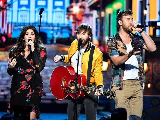 Hillary Scott, from left, Dave Haywood and Charles Kelley of Lady Antebellum perform during the Academy of Country Music Awards in Las Vegas in 2018.