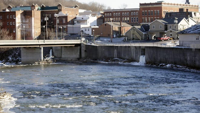 In this Jan. 21 photo, the Hoosic River runs through the village of Hoosick Falls, N.Y. In December, the EPA told the 4,500 Hoosick Falls residents who use the village system to stop drinking the water. New York officials traced the contamination to the site of the village's largest employer, a factory acquired by Saint-Gobain. PFOA has also been found in wells in nearby North Bennington, Vermont.