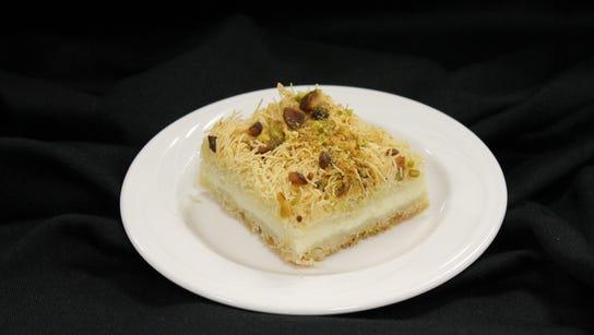 Kunafa, a pastry with shredded filo, heavy cream custard,