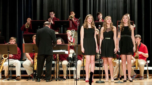 """Sisters Mia, Selene and Carson Klasner perform """"Boogie Woogie Bugle Boy"""" with the Jazz Titans."""