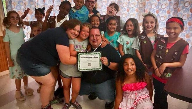 Volunteer of Excellence recipient Joe Wilson, from Port St. Lucie, receives his award from a group of grateful Girl Scouts.