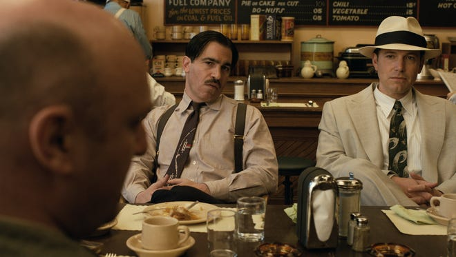 Dion Bartolo (Chris Messina, center) and his boss Joe Coughlin (Ben Affleck) meet up with villainous Tampa Klansman RD Pruitt (Matthew Maher) in 'Live by Night.'
