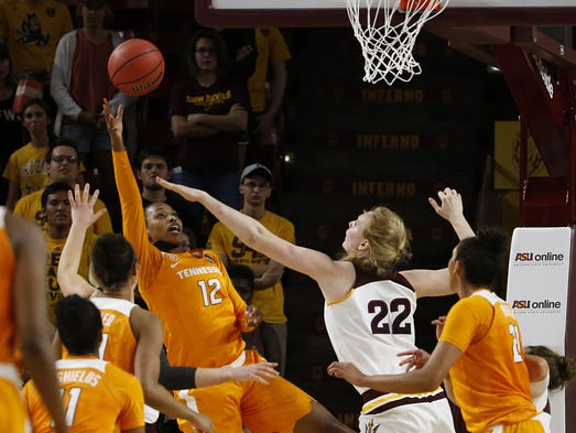 Tennessee's Bashaara Graves (12) makes a shot over