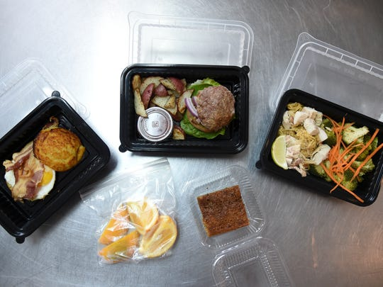 From left, paleo biscuit with eggs and bacon, oranges, an open-faced burger with roasted red potatoes, coffee cake with almond and tapioca flours, and a zucchini-noodle Pad Thai are served at Boka Box in Hagåtña on Dec. 8, 2016.