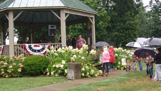 The rain did not deter visitors who gathered at the court square gazebo Saturday during Appalachian Bacon Nation. The festival is just one event Our Town Coshocton uses to help draw visitors to the downtown area.