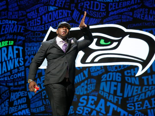 Alabama''s Jarran Reed celebrates after being selected by the Seattle Seahawks as the 49th pick in the second round of the NFL draft Friday in Chicago.