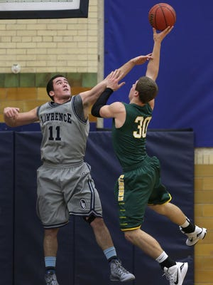St. Norbert College's Andrew Schwoerer shoots with Lawrence University's Ryan Depouw defending during their basketball game Wednesday, January 7, 2015, at Alexander Gymnasium in Appleton.