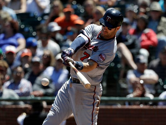 Minnesota Twins' Joe Mauer singles during the fifth inning of a baseball game against the San Francisco Giants, Sunday, June 11, 2017, in San Francisco. (AP Photo/Marcio Jose Sanchez)