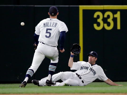 Seattle Mariners left fielder Seth Smith can't get to the ball, while shortstop Brad Miller (5) watches on a single by San Francisco Giants' Angel Pagan during the eighth inning of a baseball game Thursday, June 18, 2015, in Seattle. (AP Photo/Elaine Thompson)