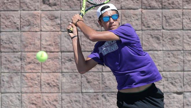 Franklin junior Sebastian Herrera returns a shot to Coronado's David Cenk during their District 6A championship match earlier this month at Americas High School. Cenk won in three sets.