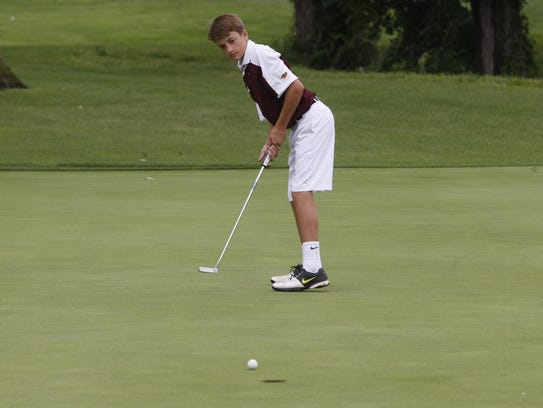 Ankeny's Thomas Nygren attempts a putt on the No. 9