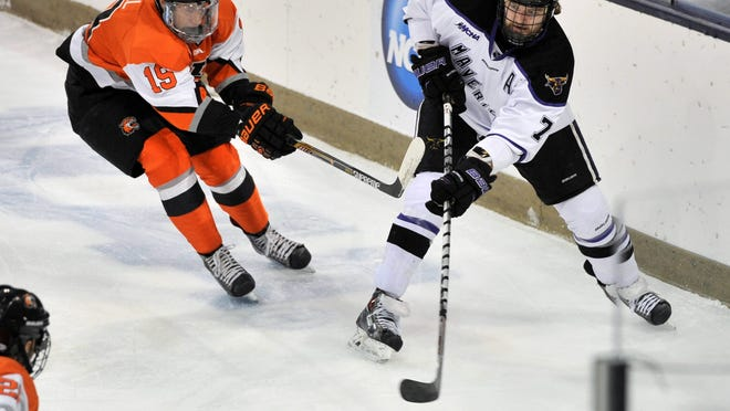 RIT's Myles Powell defends Minnesota State Mankato's Zach Palmquist on Saturday in South Bend, Ind.