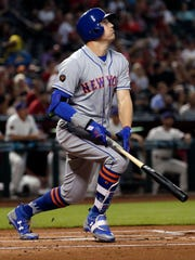 New York Mets' Brandon Nimmo watches his solo home run against the Arizona Diamondbacks during the first inning of a baseball game Thursday, June 14, 2018, in Phoenix.