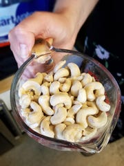 Cashews are soaked before grinding and pressing to