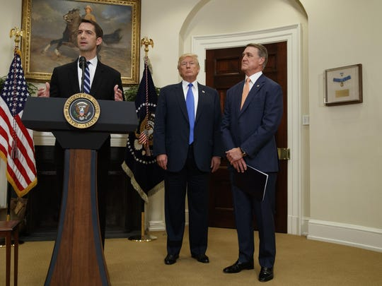 President Donald Trump, center, and Sen. David Perdue, R-Ga., right, listen as Sen. Tom Cotton, R- Ark. speaks in the Roosevelt Room of the White House in Washington, Wednesday, Aug. 2, 2017, during the unveiling of legislation that would place new limits on legal immigration. (AP Photo/Evan Vucci)