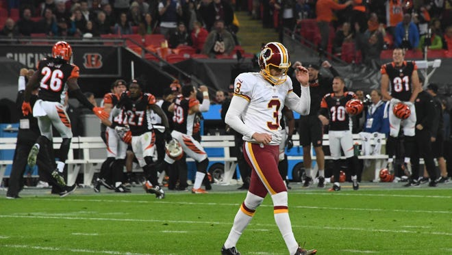 Washington Redskins placekicker Dustin Hopkins (3) reacts after missing a 34-yard field goal in overtime against the Cincinnati Bengals during game 17 of the NFL International Series at Wembley Stadium.