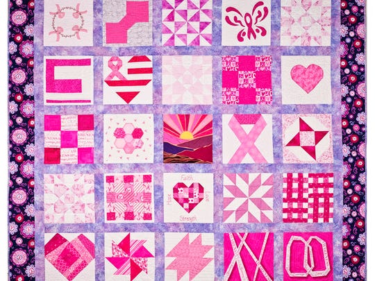 """Hugs and Kisses"" quilt completed by the guild from squares entered during the Quilt for the Cure challenge. It features 25 blocks donated from 20 different community members aged 6 to 83."