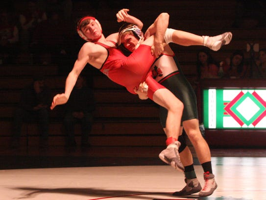 Oak Harbor's Garrett Mapes throws Bellevue's Braxton