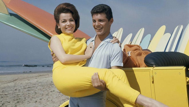 Frankie Avalon and Annette Funicello during filming of 'Beach Party' in California.