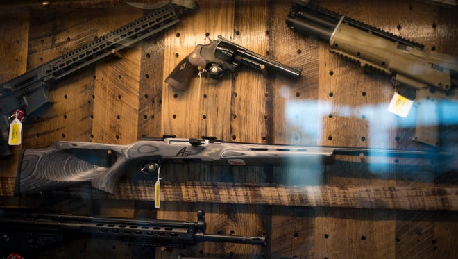 An array of rifles and handguns are on display as prizes at the NRA meeting in Louisville.