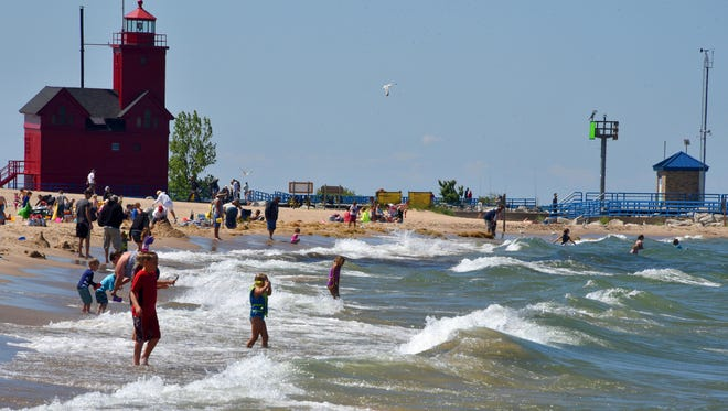 Ottawa Beach at Holland State Park uses the state Department of Natural Resources' flag-warning system to alert swimmers to water dangers.