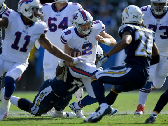 Buffalo Bills quarterback Nathan Peterman (2) gets tackled by Los Angeles Chargers during the first half of an NFL football game Sunday, Nov. 19, 2017, in Carson, Calif. (AP Photo/Mark J. Terrill)