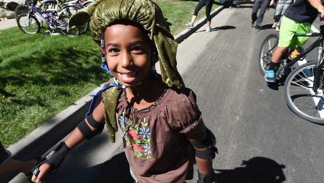 Zinash Mumma, 8, skates down Remington Street during an Open Streets event Sunday, September 20, 2015. The events encourage people to use alternative forms of transportation to experience healthy activities at the festival.