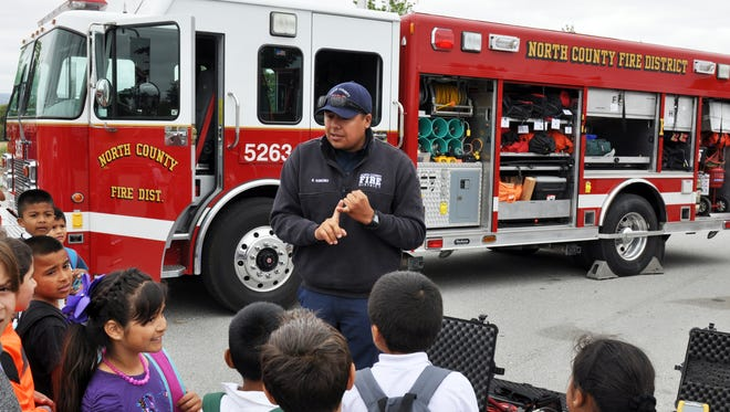 North County Firefighter Randy Sanchez, explains some of the functions of his urban search-and-rescue fire engine at Wednesday's annual Emergency Medical Services Week event in Salinas.