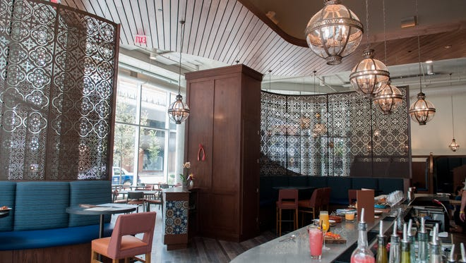 Mita's decor showcases the intricate detailing of Spanish and Colombian influences. The lighting brings a Moorish flair.